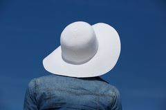 Woman with summer hat. Close up rear portrait of a woman with summer hat Royalty Free Stock Image