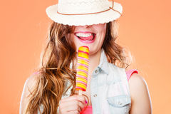 Woman in summer hat eating ice pop cream Stock Photo