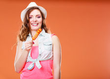 Woman in summer hat eating ice pop cream Stock Images