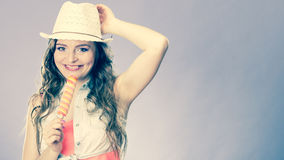 Woman in summer hat eating ice pop cream Royalty Free Stock Photography