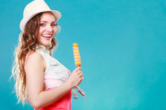 Woman in summer hat eating ice pop cream Stock Photos