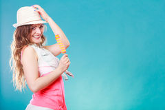 Woman in summer hat eating ice pop cream Royalty Free Stock Photos