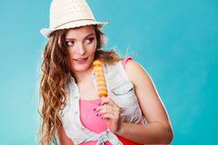 Woman in summer hat eating ice pop cream Royalty Free Stock Images