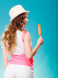 Woman in summer hat eating ice pop cream Stock Photography