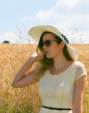 Woman with summer hat Stock Photos