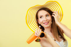 Woman in summer hat holds sunglasses sunscreen lotion Royalty Free Stock Photography