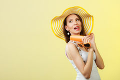 Woman in summer hat holds sunglasses sunscreen lotion Stock Photo