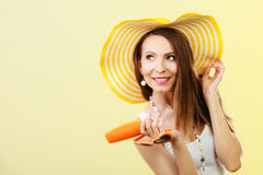 Woman in summer hat holds sunglasses sunscreen lotion Stock Photography