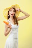 Woman in summer hat holds sunglasses sunscreen lotion Royalty Free Stock Photo