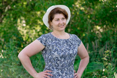 Woman in summer hat on nature Royalty Free Stock Photo