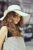 Woman in summer hat outside Royalty Free Stock Image