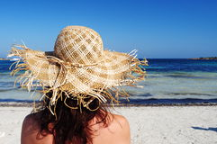 Woman,summer and holiday. Woman with straw hat lookink sea of sardinia Royalty Free Stock Photo