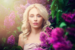 Woman with Summer Light and Lilac Flowers Outdoors. You Stock Images