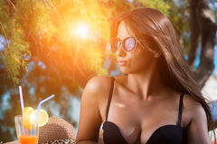 Woman at the summer lounge royalty free stock image