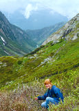 Woman in summer mountain (St. Gotthard Pass, Switzerland). Stock Photos