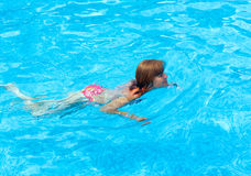 Woman in the summer outdoor pool. Stock Images