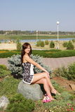 Woman in a summer park. Young beautiful woman in a summer park Stock Photos