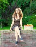 Woman in summer park. Beautiful woman having picnic in summer park stock image