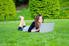 Woman in summer park Royalty Free Stock Image