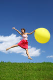 Woman in summer pushes off from earth Stock Image
