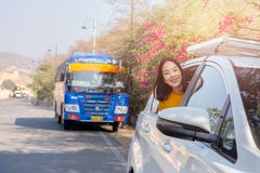 Woman on summer roadtrip leaning out car window travel vacation concept. stock photography