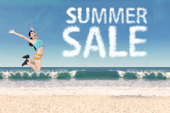 Woman with summer sale clouds at beach Royalty Free Stock Photos