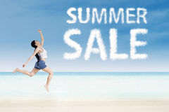 Woman with summer sale clouds Stock Photography