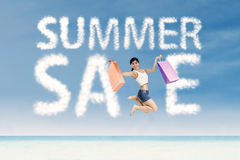 Woman and summer sale clouds Royalty Free Stock Image