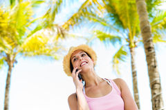 Woman on summer tropical vacation smartphone call Royalty Free Stock Photo