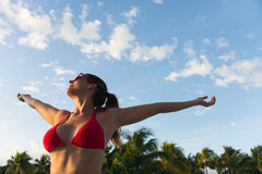 Woman on summer vacation relax and fun at tropical resort. Woman enjoying tropical vacation at caribbean resort swimming pool. Female happy girl having fun at Stock Image