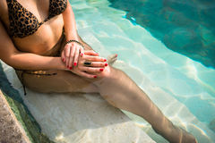 Woman on summer vacation sitting in Swimming Pool royalty free stock photography