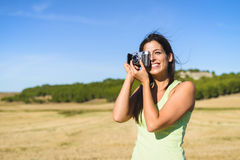 Woman on summer vacation taking photo Royalty Free Stock Photos