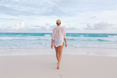 Woman on summer vacations at tropical beach of Mahe Island, Seychelles. Stock Photos