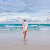 Woman on summer vacations at tropical beach of Mahe Island, Seychelles. Royalty Free Stock Photo