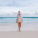 Woman on summer vacations at tropical beach of Mahe Island, Seychelles. Royalty Free Stock Photos