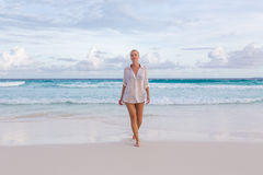 Woman on summer vacations at tropical beach of Mahe Island, Seychelles. Royalty Free Stock Image