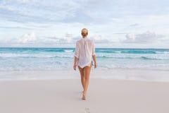 Woman on summer vacations at tropical beach of Mahe Island, Seychelles. Stock Photos