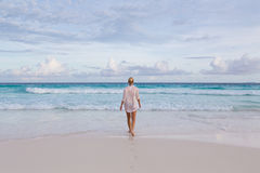 Woman on summer vacations at tropical beach of Mahe Island, Seychelles. Stock Photo