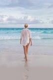 Woman on summer vacations at tropical beach of Mahe Island, Seychelles. Royalty Free Stock Image
