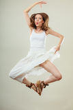 Woman in summer white dress jumping Stock Images