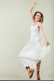 Woman in summer white dress jumping Stock Photos