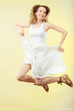 Woman in summer white dress jumping Royalty Free Stock Photo
