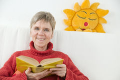 Woman with sun and book front Royalty Free Stock Image