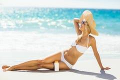 Woman with sun cream on beach Royalty Free Stock Photos