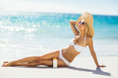 Woman with sun cream on beach Royalty Free Stock Photography