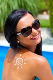 Woman with sun cream by the pool Royalty Free Stock Photography