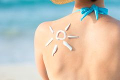 Woman with sun drawn from sunscreen on back Royalty Free Stock Images