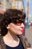 The woman in sun glasses Royalty Free Stock Images