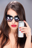 Woman with sun glasses holding can Royalty Free Stock Image