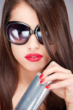 Woman with sun glasses holding can Royalty Free Stock Images